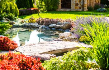 A landscaped garden with hardscapes and water features.