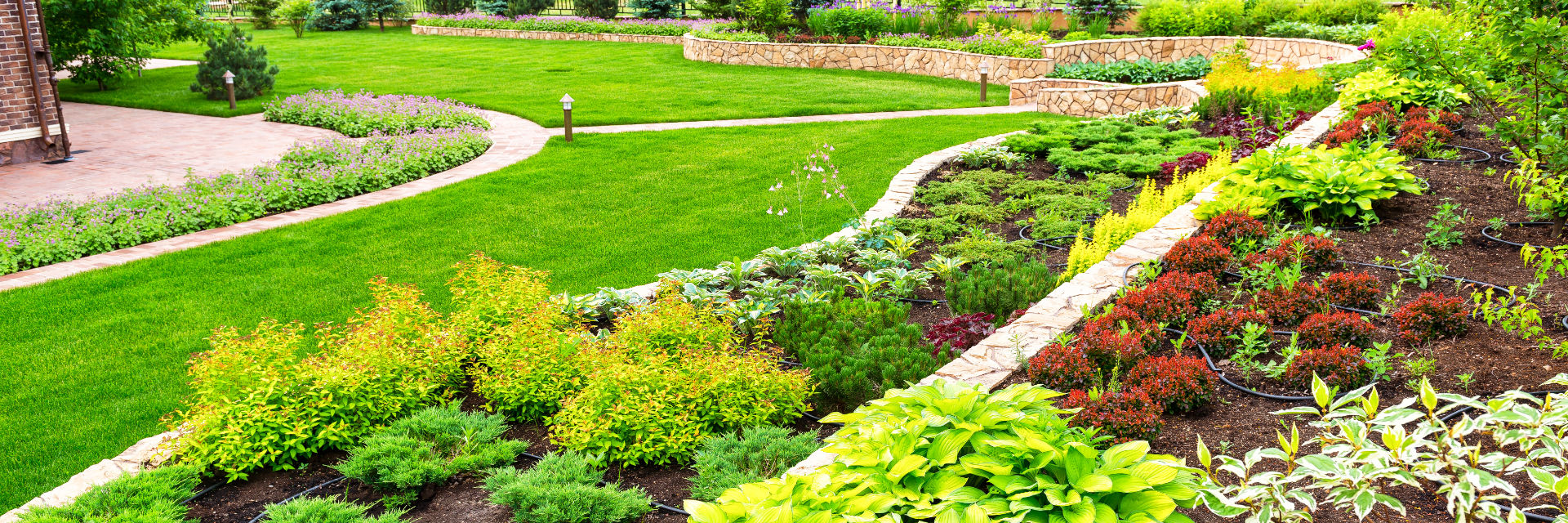 Professionally landscaped backyard with manicured lawn.